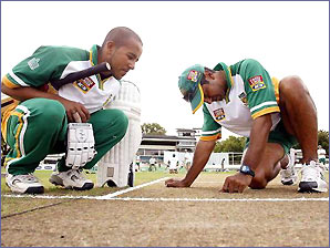 South African players inspect the wicket