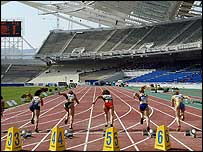 Competitors running at the Olympic Stadium