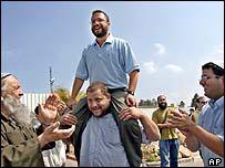 Noam Federman (top) with supporters, June 2004