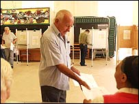 A voter arrives at a polling station