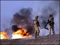 British soldiers watch Iraqi gas on fire