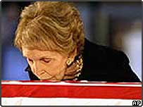 Nancy Reagan kisses her late husband's coffin