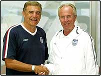 England Manager Sven-Goran Ericksson (R) congratulating Trevor Brooking after Trevor received a Knighthood in the Queen's Honours List