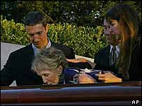 Nancy Reagan (centre) is joined by sons Ron (left), Michael (second right) daughter Patti Davis as she kisses the coffin bearing her husband