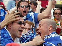 Stylianos Giannakopoulos celebrates with the Greece fans