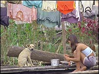 Peruvian girl washing clothes