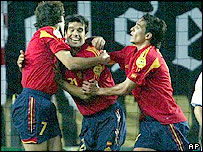 Spain celebrate their goal through substitute Juan Carlos Valeron