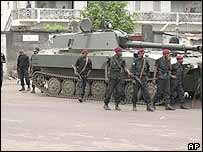 Congolese army guard a street with a tank after a coup attempt in Kinshasa