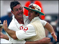 Ashley Giles celebrates with captain Michael Vaughan