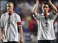 David Beckham (left) and Gary Neville are dejected at the final whistle