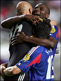 Fabien Barthez is hugged by Patrick Vieira