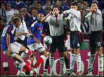 Zinedine Zidane scores France's equaliser with a free-kick.