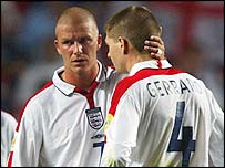 David Beckham consoles Steven Gerrard after England's 2-1 defeat by France