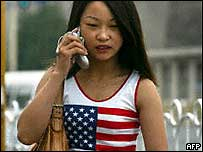 A young woman talking on a mobile phone in Beijing