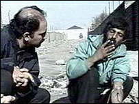 Dr Arash Alaei with a heroin addict in Tehran