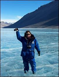 Kim Griggs stands atop Lake Vanda, Griggs