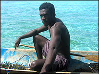 Man in canoe, Rarumana island, Western province