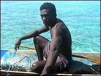 Man in canoe, Rarumana island, Western province