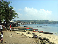 Market stalls with canoes on the bay in Gizo, Western Province
