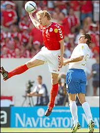 Denmark defender Martin Laursen beats striker Christian Vieri to a header