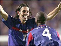 Robert Pires celebrates with France