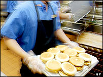 Burgers being prepared in McDonalds