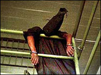 An Iraqi prisoner at Abu Ghraib