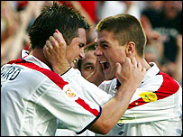Frank Lampard celebrates with Steven Gerrard after scoring against France