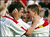 Frank Lampard celebrates with Steven Gerrard after scoring against France