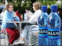 Dasani bottles on a cafe table