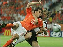 Ruud van Nistelrooy gets the better of defender Christian Worns to score for Holland