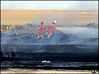 Firefighters at pipeline