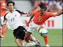 Michael Ballack and Edgar Davids challenge for the ball