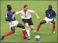 Wayne Rooney runs through the French defence