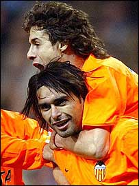 Roberto Ayala (ottom) celebrates his goal against Real Madrid with team-mate Pablo Aimar