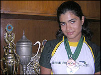 Rubab Raza with swimming trophies