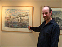 Photo of David Downes next to one of his paintings