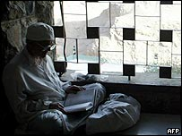 Zoroastrian man reads sacred text at Chakchak temple