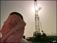 Saudi official watching oil well