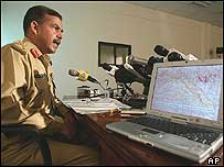 Pakistan military spokesman Major General Shaukat Sultan with a map of the area of operations