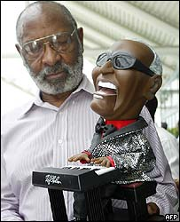 Rev Charles Peters with Ray Charles doll
