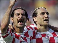 Croatia's Dovani Rosso and Dado Prso celebrate the second goal against France