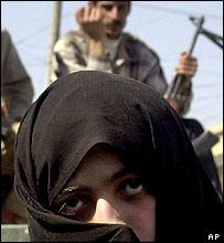 Shia pilgrim, with guard