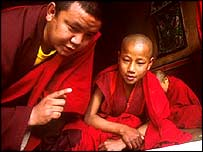 A Bhutanese novice monk in class
