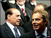 Italy's Silvio Berlusconi (L) and UK PM Tony Blair