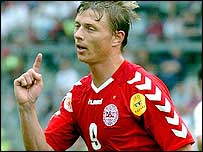 Jon-Dahl Tomasson celebrates scoring Denmark's first goal of Euro 2004