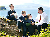 Pupils  Ruari, 11, Connor,10  and Eoin,5, with their teacher Brian McCaughan
