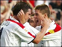 England midfielders Frank Lampard and Steven Gerrard celebrate