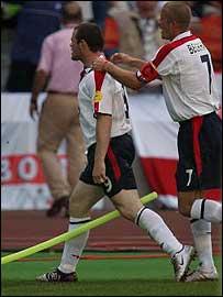Wayne Rooney celebrates his opening goal against Switzerland with captain David Beckham