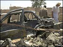 Twisted wreckage of car after strike in Falluja